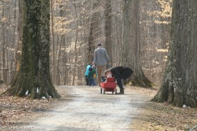 a family on the self guided maple syrup tour at Dawes Arboretum