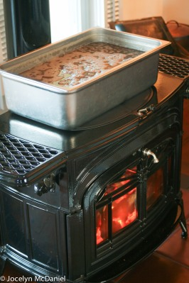 photo of sap simmering on a wood stove