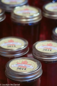 Photo of labelled jars of finished maple syrup