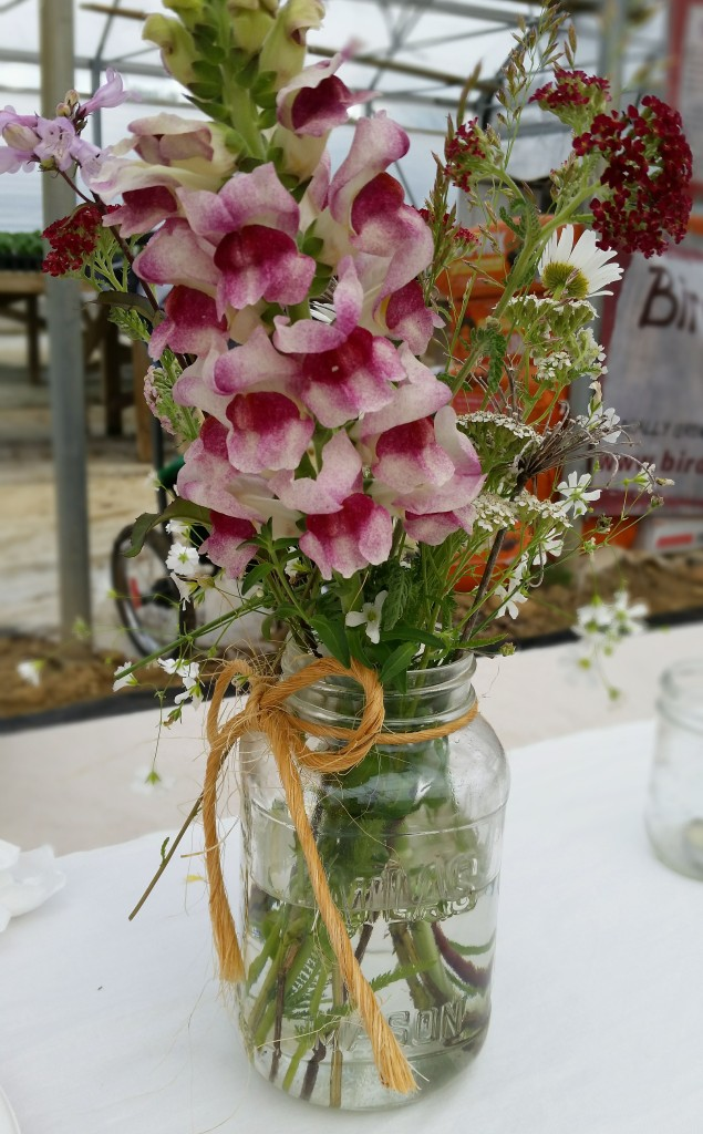 photo of flower arrangement in a mason jar