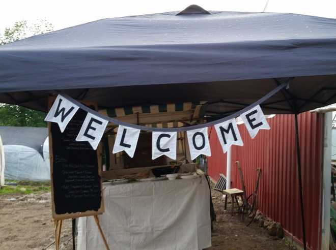 photo of a welcome sign at a farm to table dinner
